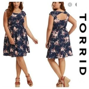 Torrid flower dress is navy and pink. Size 4x